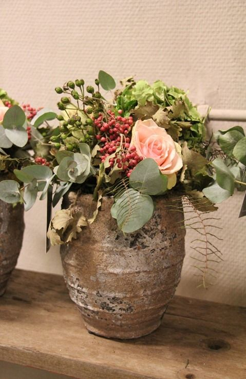 Antique olive jars with flowers, herbs and berries....you will need this for your wine cellar/tasting room!
