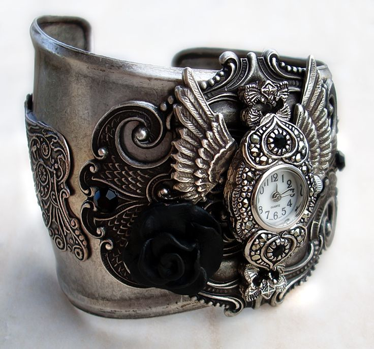 """Steampunk - Gothic Cuff Watch1  by *Aranwen  Artisan Crafts / Jewelry©2008-2012 *Aranwen  After popular request, I made a silver version of the steampunk cuff watch. Currently reserved.    I hope you like it     Silver plated brass, hand-sculpted polymer clay rose, working watch face.  So I tried to make a similar theme like the previous watch that everyone loved so much. It has some """"steam punk"""" elements plus the silver colour and black rose that give it a gothic essence."""
