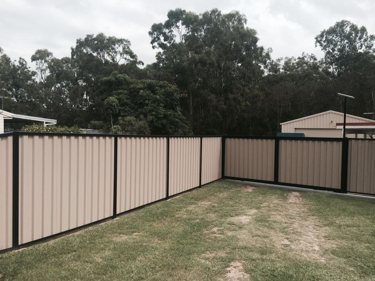 Colourbond fence with solar powered automatic sliding gate at Deception Bay
