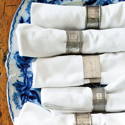 Add Bling with Rings | Embellish simple white cotton napkins with a collection of vintage silver napkin rings. Gather a collection over time at various antiques markets and estate sales. The quirkier the markings, the better | SouthernLiving.com