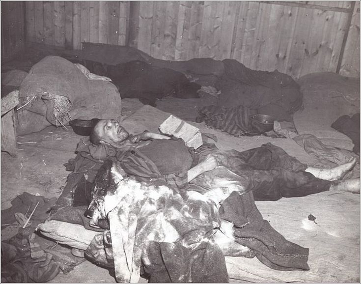 Mauthausen - inmate lies dying on filthy rags