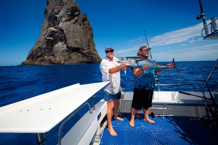 Fishing on the boat off Ball's Pyramid. Two ecstatic fishing partners catch of the day!      http://www.lordhoweisland.info/gallery/    #lordhoweisland #Australia #NSW #fishing