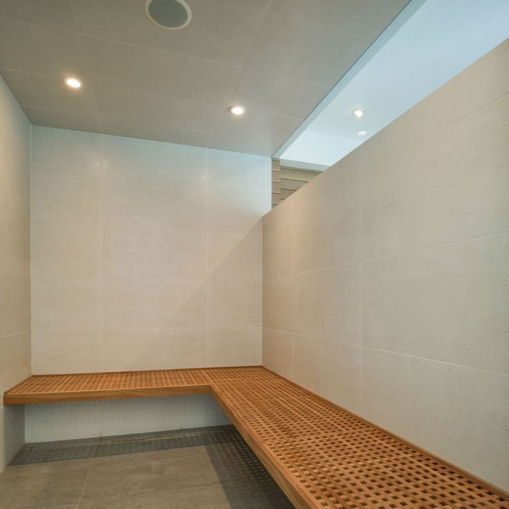 Contemporary Sauna Steam Room Design With Wall Mounted Wooden Bench. yes please.