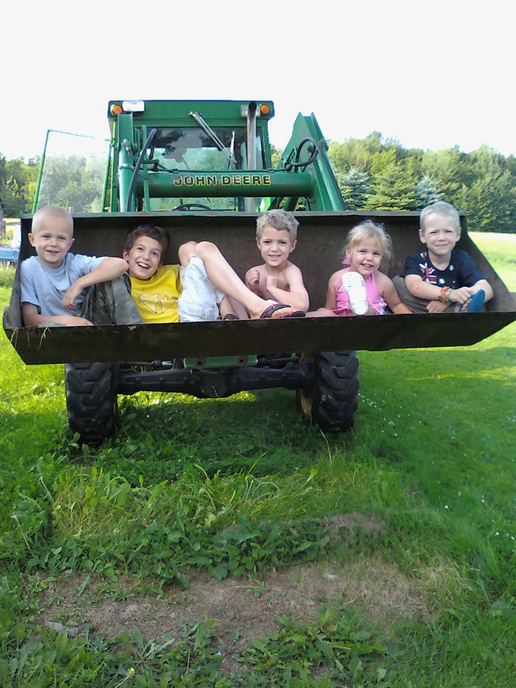 Summer on the farm- My dad always let us ride in the bucket, we loved it! and we still do... :)