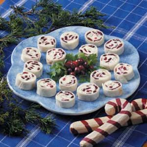 """Cranberry Feta Pinwheels Recipe -These pretty pinwheels will disappear so fast, it will make you head spin! """"The dried cranberries and chopped green onions make these perfect for a Christmas buffet,"""" suggests Joyce Benninger from Owen Sound, Ontario"""