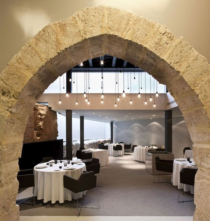 Caro Hotel   Minimalistic Design and Historical Decor gothic arches caro hotel