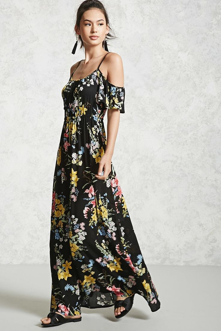 A crepe woven maxi dress featuring an open-shoulder design, an allover floral print, adjustable cami straps, short sleeves, an elasticized bodice, and a flowy silhouette.