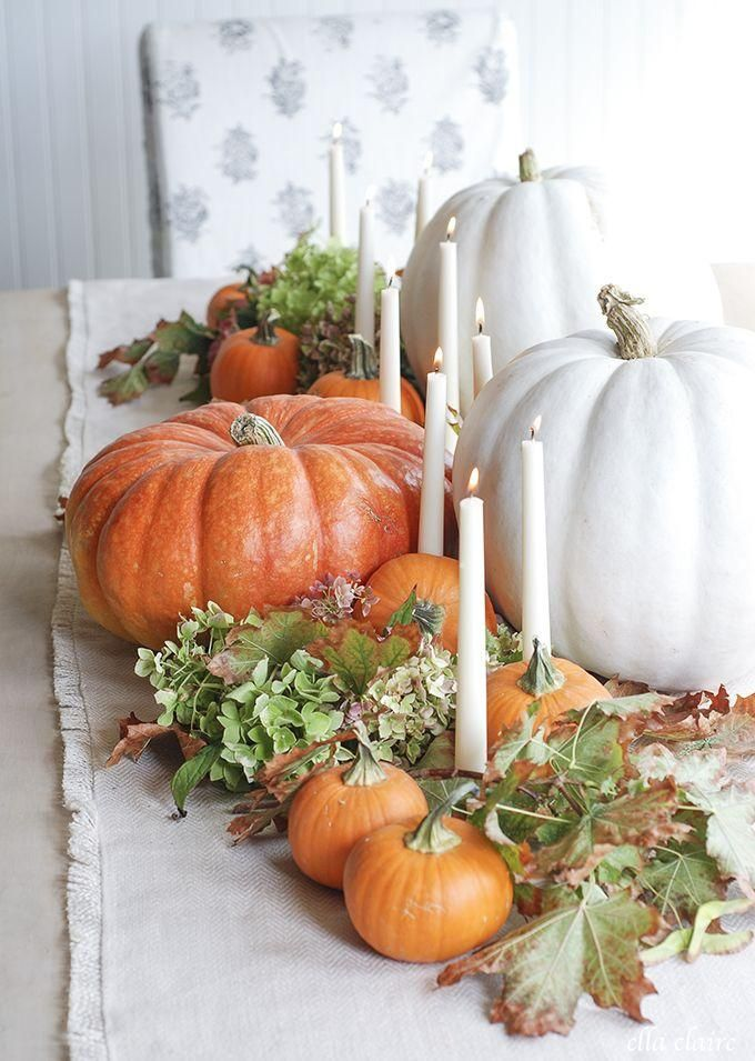 Fall centerpieces don't have to be dark - keep your display cottage-chic by incorporating lighter colors, like these white pumpkins and candlesticks.