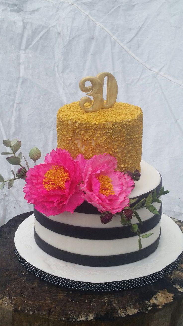 Birthday cake. Sugar flowers. Gold confetti.
