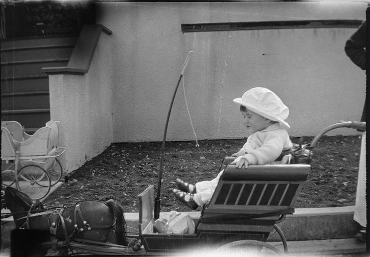 Joseph P. Kennedy, Jr., sits in a baby carriage (in the style of a horse-drawn buggy) at Nantasket Beach, Hull, Massachusetts.
