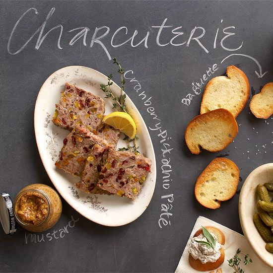 Charcuterie Tray: A chic charcuterie platter will always have some variety of pâté. Try this cranberry- and pistachio-studded version served with stone-ground mustard. Serve with Baguette slices, Cornichons, and Apple or pear slices,  (See separate pin for the Cranberry Pistachio Pate)