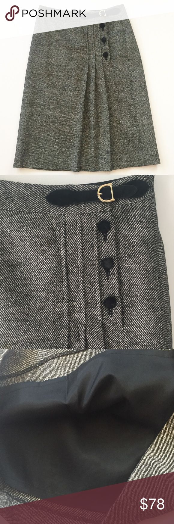 Milly of New York Silk + Wool Tweed Skirt Sz 2 Milly of New York Silk + Wool Tweed Skirt Sz 2 🛍 Excellent condition. 2nd + 3rd buttons have slight wear, please see last photo.   * Shell/Exterior: 46% Wool, 27% Silk, 1% Lycra * Combo: 100% Silk * Combo Trim: 100% Suede  * Lining: 100% Acetate * Made in USA of imported fabric from Spain  * Left front buckle with gold colored clasp  * 3 black front buttons with inside clasp closure  * Front pleating * Measurements: waist 28, hips 32, length 25…