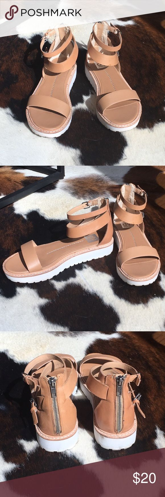 """Tan ankle strap flat forms Edgy tan dolce vita platform sandals with a double ankle strap, a minimalist front strap, and silver hardware. They have a zipper in the back so they are easy to get on. The platform is a modern white and about 1"""". Barely worn and in good condition with only minor discoloration on the sole. DV by Dolce Vita Shoes Platforms"""
