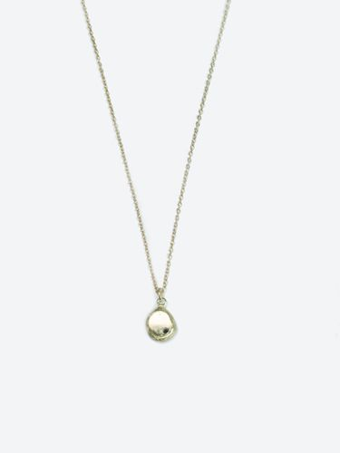 "Macha raw gold necklace    A nugget of recycled gold set with a tiny inverted black diamond. Specifications: All 14k gold, 1mm black diamond. 6mm pendant 16"" chain      #giftsforher #diamondnecklace #blackdiamond #goldcharm #goldnugget #recycledgold #giftsforher #goldnecklaces"