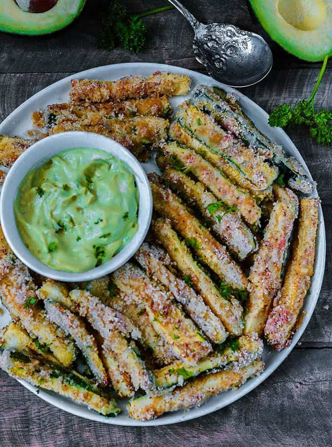 These delicious Baked Zucchini Fries, are gluten-free, vegan and low carb. They are so addictive that they will be gone before you know it!