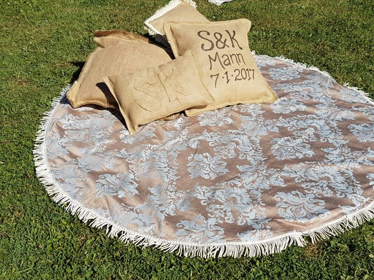 Hessian cushions and vintage picnic rug. Rustic country wedding.