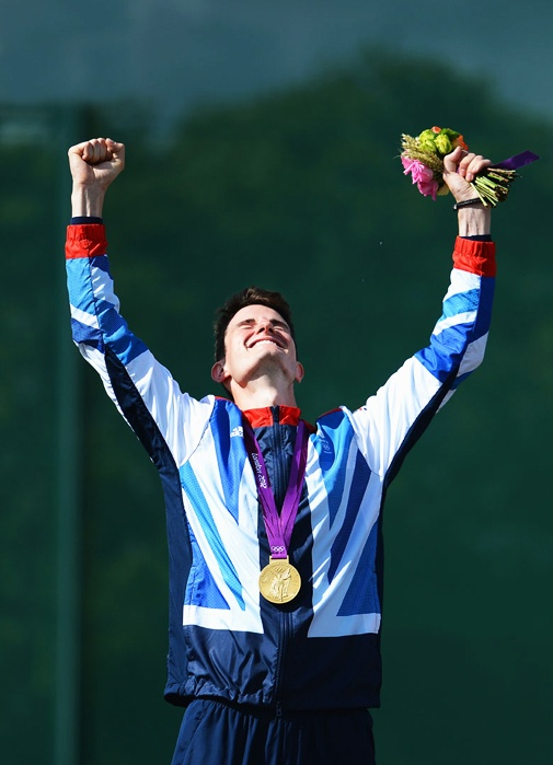 Peter Robert Russel Wilson of Great Britain celebrates with his gold medal during the medal ceremoy following the Men's Double Trap Shooting final on Day 6 of the London 2012 Olympic Games at The Royal Artillery Barracks on August 2, 2012 in London, England.