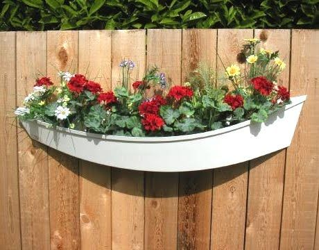 Great DIY idea for the garden, could possibly find *free* boat on craigslist! -Boat Planter