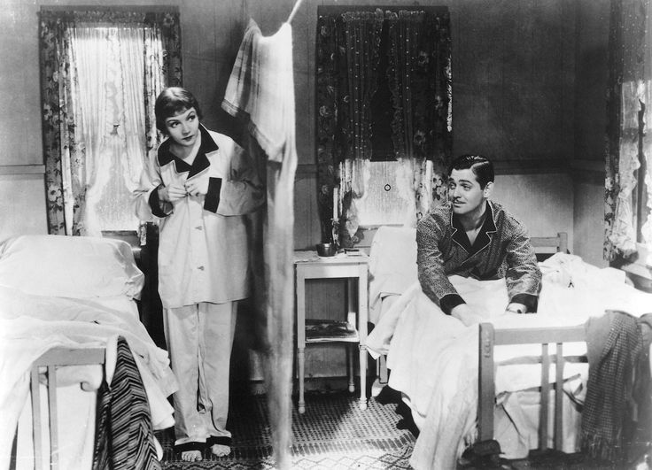 """""""BEHOLD THE WALLS OF JERICHO!"""" Clark Gable and Claudette Colbert are unlikely travel companions in It Happened One Night. He is a wise-cracking newspaper reporter and she is a runaway socialite, and to save money they share a motel room. Gable dubs the blanket separating them """"the walls of Jericho."""" Multiple generations of audiences have fallen in love with this classic romantic comedy (and the first """"screwball comedy"""") and Gable and Colbert won Oscars for their performances."""