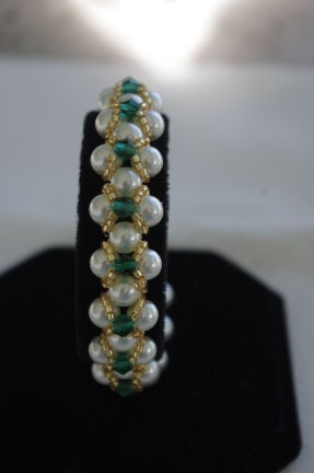 Beautiful pearl and crystal bracelet. Perfect for the bride, maid of honor or mother of the bride. Available in many colors, clear to look like diamonds or any wedding colors. Available in silvertone or goldtone beads. $50.00