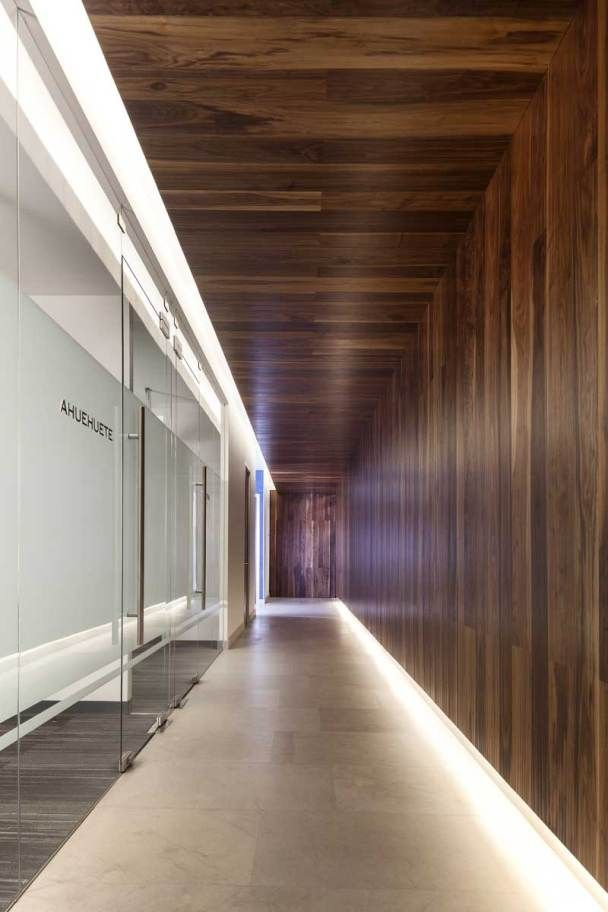Textured wood for this modern and clean corridor.