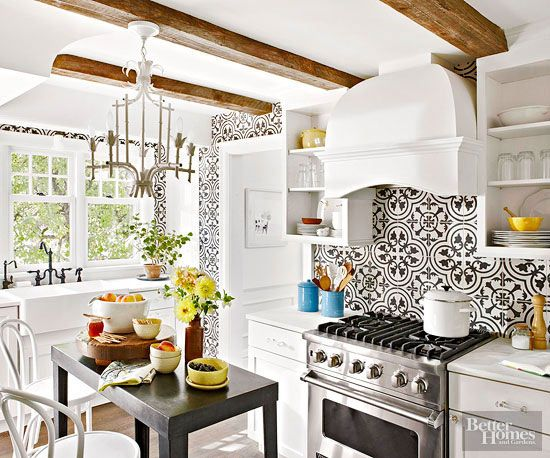 Layer in striking architectural elements to emulate the assembled-over-time appeal that defines vintage European kitchens. Here, rough-hewn ceiling beams provide rustic counterpoints to more elegant elements, such as ornate tiled walls and substantial painted woodwork. Round out the look with vintage-style chandeliers, faucets, and furnishings./