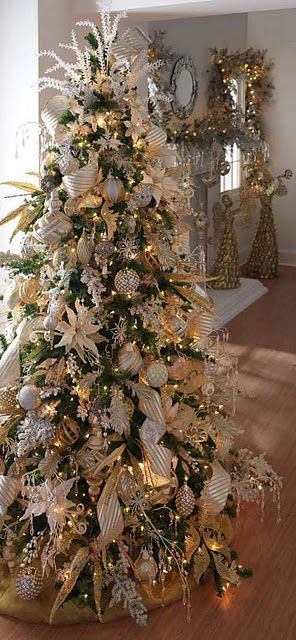 I love over the top trees like this.  When I have a house I would like to have a the traditional family one and my styled one.  It reminds me of the trees I did at Engwalls.