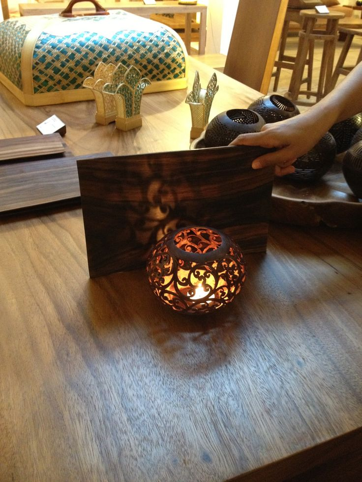 Carved coconut shell with T-light in it.