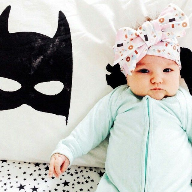 Adorable baby playing pretend with cool batboy pillow from Little Pop Studio. We are the only Stockists in Canada.
