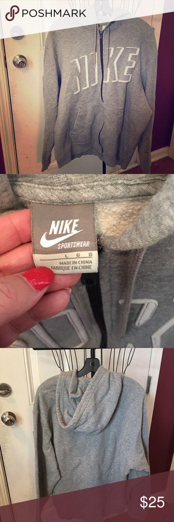 Nike zipper hoodie Nike zipper hoodie. Grey with white lettering on front. Nike Shirts Sweatshirts & Hoodies