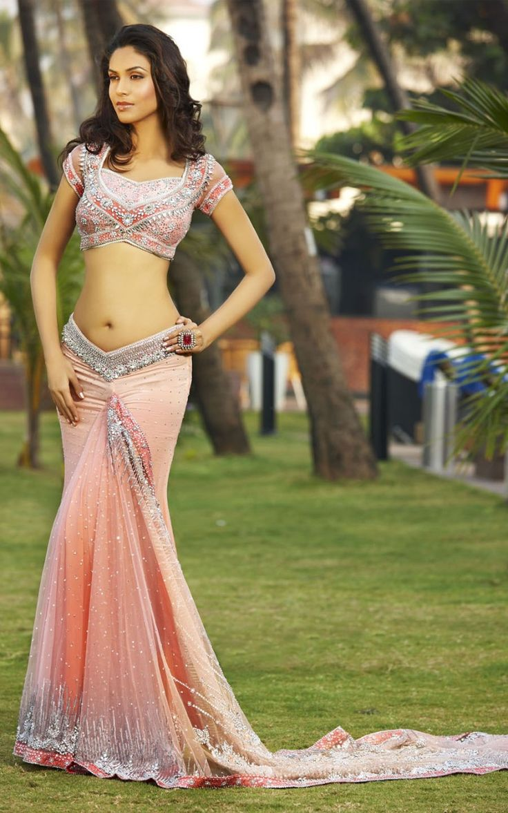 A Stunning Modern Ready to Wear Saree with the Pallu attached to the pleats is a perfect combination of Elegance and Style. The Velvet Border on the Saree and Blouse adds a beautiful finish the heavy Sequins, Swaroski and Stone embellishments. Chiffon Saree with delicate ribbon work touches on the net pallu completes the look.