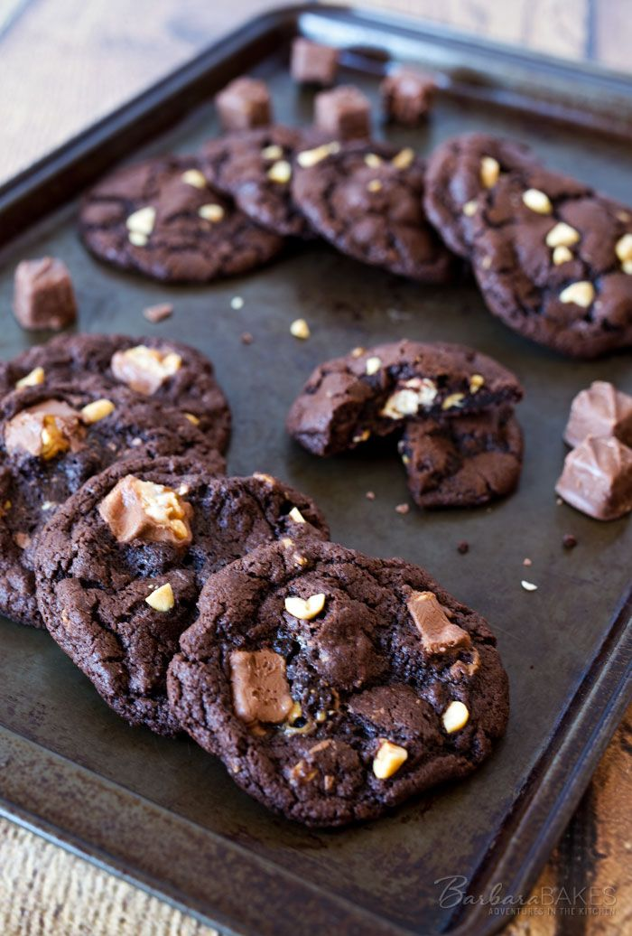 These Chocolate Snickers Cookies are an irresistible, rich, chewy chocolate cookie loaded with chocolate chips, peanuts and Snickers Baking Bites.