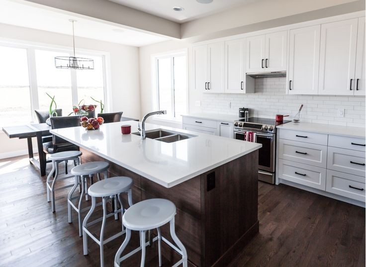 This modern kitchen features Lauzon's Red Oak flooring. This extremely durable wood offers rich reddish color and distinctive grain. Photo by Lexis Homes for the Rosewood Show Home.