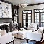 living rooms - taupe moldings French doors built-ins flanking fireplace canvas art cream tufted cube ottomans white sofa chairs espresso wood frame