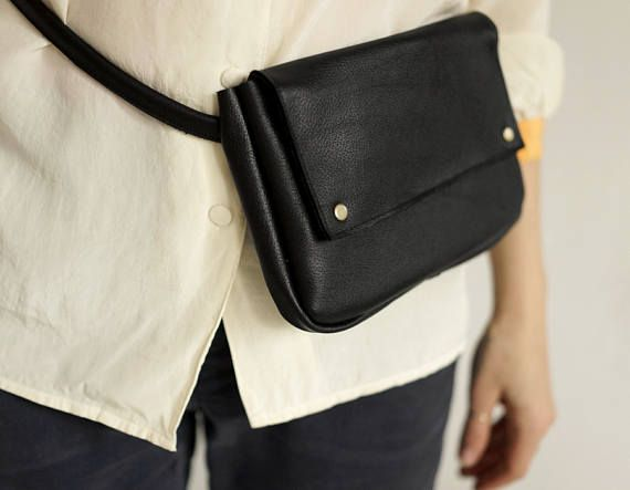 Universal and elegant leather fanny pack. Holds whatever you may need it to hold, phone, coin purse, card holder, usb, a few keys, etc. Made of soft genuine black leather. Close with old gold snaps. Adjustable strap 12mm / 0.5, lenth up to 95 cm/37,3. If You want longer strap please write to me. Dimensions: h: 14 cm /5,5 w: 23 cm/ 9  Possibly to make crossbody purse with long strap. Ready to ship in 2-3 working days.  Standard delivery time:  European union: 4 - 10 days  ...