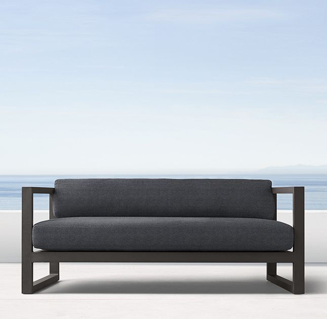 """RH's 64"""" Aegean Aluminum Sofa:Influenced by the low, linear silhouettes of seaside architecture, our contemporary collection is designed by a family-owned company in Australia known for its meticulous metalwork. Its superior materials and simple geometry enable it to weather the elements in enduring style."""