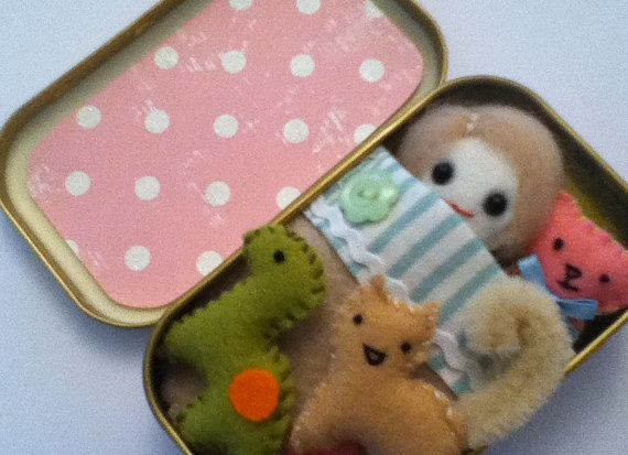 doll in a tin with kitten dinosaur and teddy bear comes with bedding too. $25.00, via Etsy.
