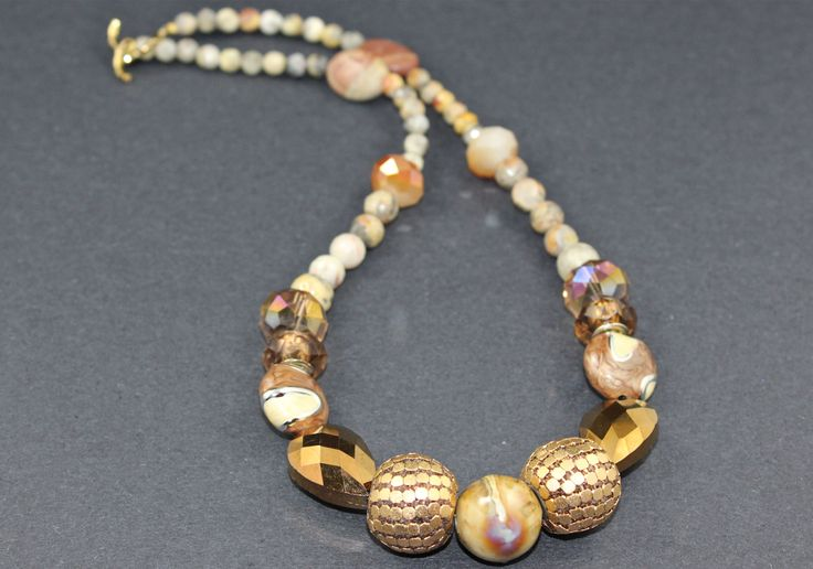 "Custom made 20"" long necklace with semi precious gem stones$55.00"