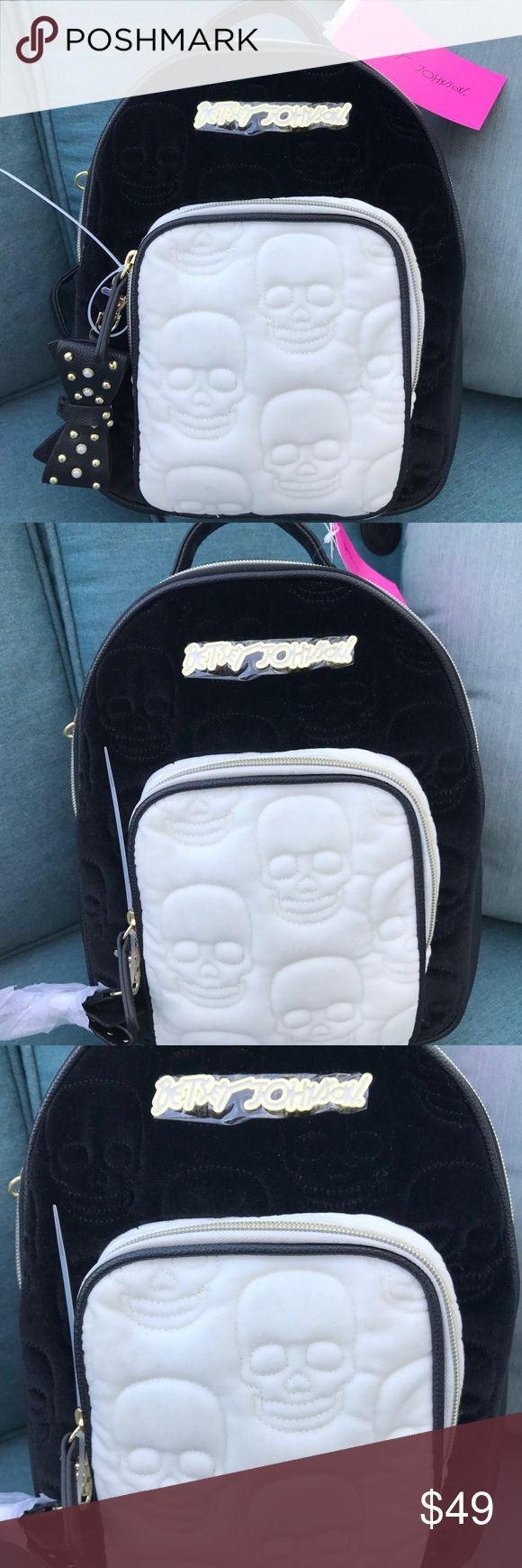 NWT Betsey Johnson Skull Velvety Black Backpack Adorable Betsey Johnson new Black and cream backpack with black stud bow detail. Adjustable back straps, front pocket, large zipper pocket with grey rosebud lining and zip and slip pockets. BNWT and in perfect shape. Retails for $88. Betsey Johnson Bags Backpacks