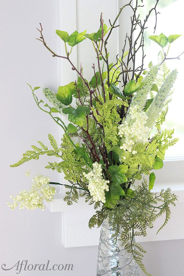 Find artificial greenery for your DIY floral arrangements like this beautiful green and white plastic mixed fern and berry bush.