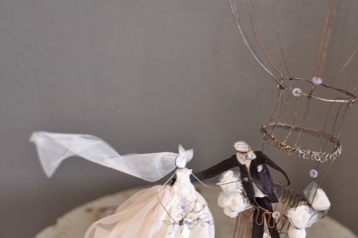 "Wedding cake topper: ""we fly away together"""