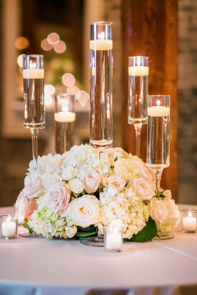 Low lush centerpiece; using ivory and blush roses with hydrangea and spray roses