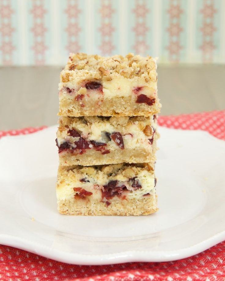 Cranberry Crumble Cheesecake Bars are deliciously sweet and tart! Cranberries, rich cheesecake, and a nutty crumb topping combine for a lovely treat. - Bake or Break