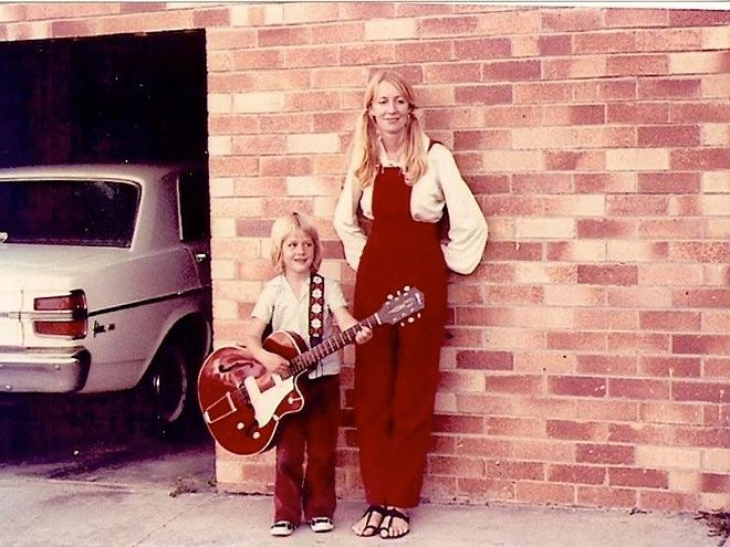 "Keith Urban's Life in Pictures | AN EARLY MENTOR | ""I feel really lucky that I had a great guitar teacher that just taught me basic chords so I could play songs,"" says Urban of his first guitar teacher, Sue McCarthy. ""I didn't want to learn theory or how to read music, I didn't want to get overwhelmed by that."""