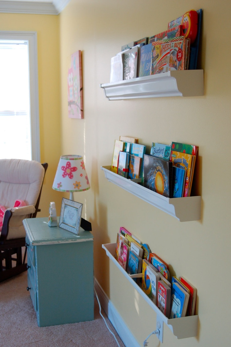 Forward Facing Book Shelf Made Out of Rain Gutters. $18.00, via Etsy.