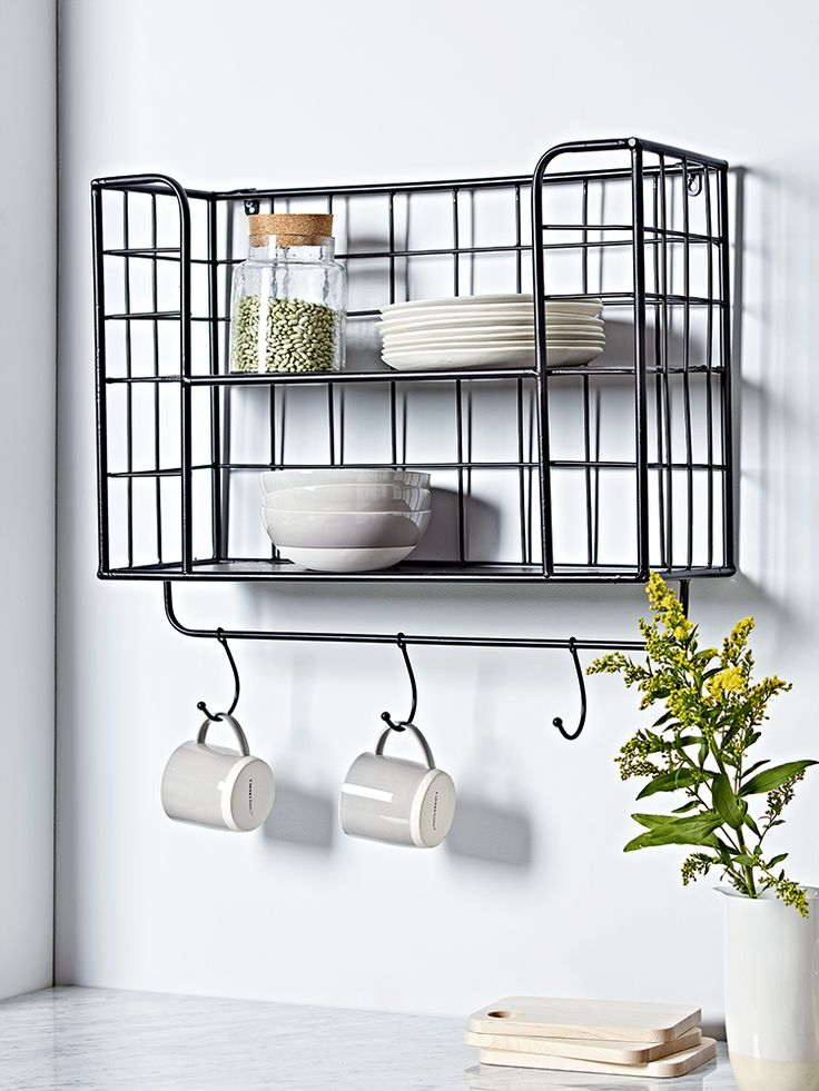 £75 Made from quality iron with a black powder coated finish, our industrial inspired storage shelf is a versatile piece of wall mounted storage for your kitchen or hallway. Each strong, weighty shelf is ideal for storing jars, bottles and boxes in your kitchen or hats, scarves and jackets in your hallway. Team with our Dip Glaze Dinnerware Collection to re-create our look.