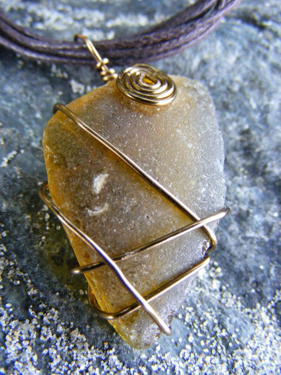 Authentic Amber Steampunk Sea Glass on Corded Necklace ($10 off until 08/20 with coupon code GRANDOPENING10)  #seaglass #seaglassjewelry #beachglass #beachglassjewelry #shophandmade #seaglassgrotto