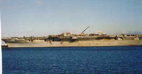 American aircraft carrier USS Bennington at the Alang, India ship breaking yard where it was broken up for scrap. American warships are prized for the high quality of steel used in their construction.