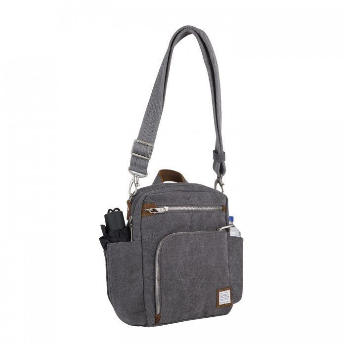 Feel comfortable and secure while you travel with this Travelon Anti-theft Heritage Vertical Messenger Bag. A roomy compartment featuring a zippered RFID blocking pocket means you won't you won't need to worry about pickpockets no matter where you go.