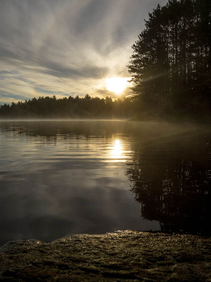 A gorgeous sunrise on a lake in Haliburton.  #Ontario #canoe #trip #camping #Canadian #sunrise